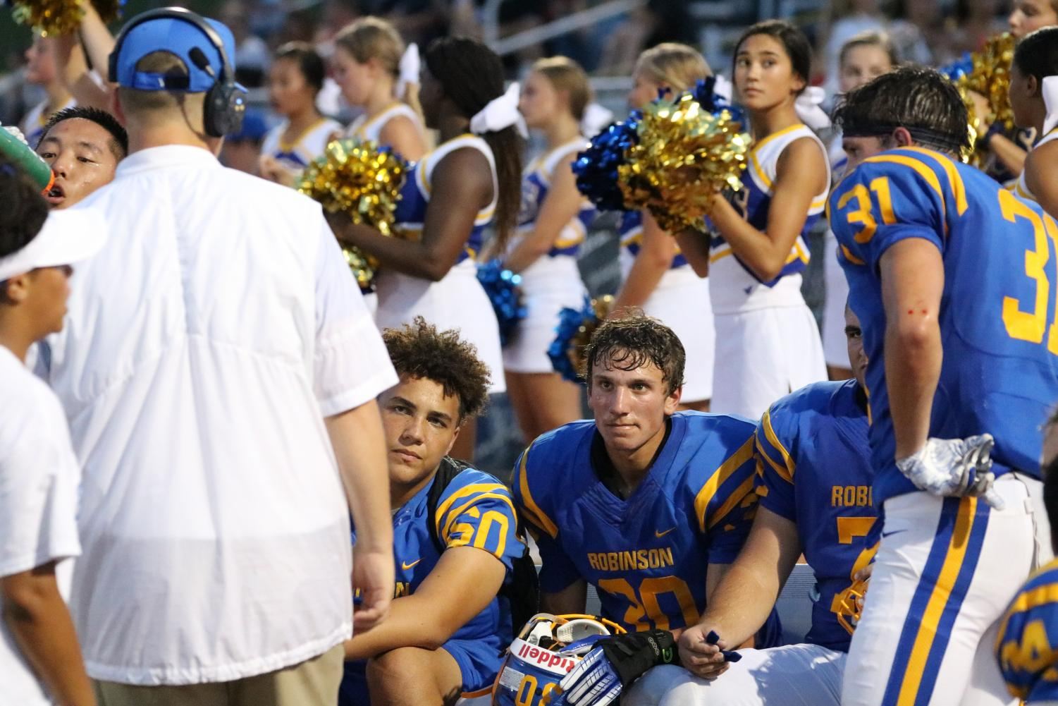 Robinson varsity football players gather on the sidelines during their win against Chantilly on August 31. Photo by Thomas Redifer.