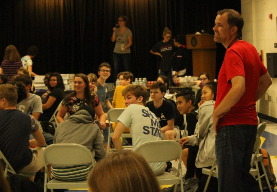 Jason Woehrmyer talks with students at the New Kids on the Block assembly on Sept. 13. Woehrmyer joined the Robinson counseling staff this year. He handles students whose last names start with A-Bram.