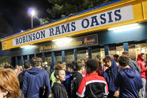 Students stand outside of the oasis at a football game. Robinson oasis has been a service for the high school for over thirty years.