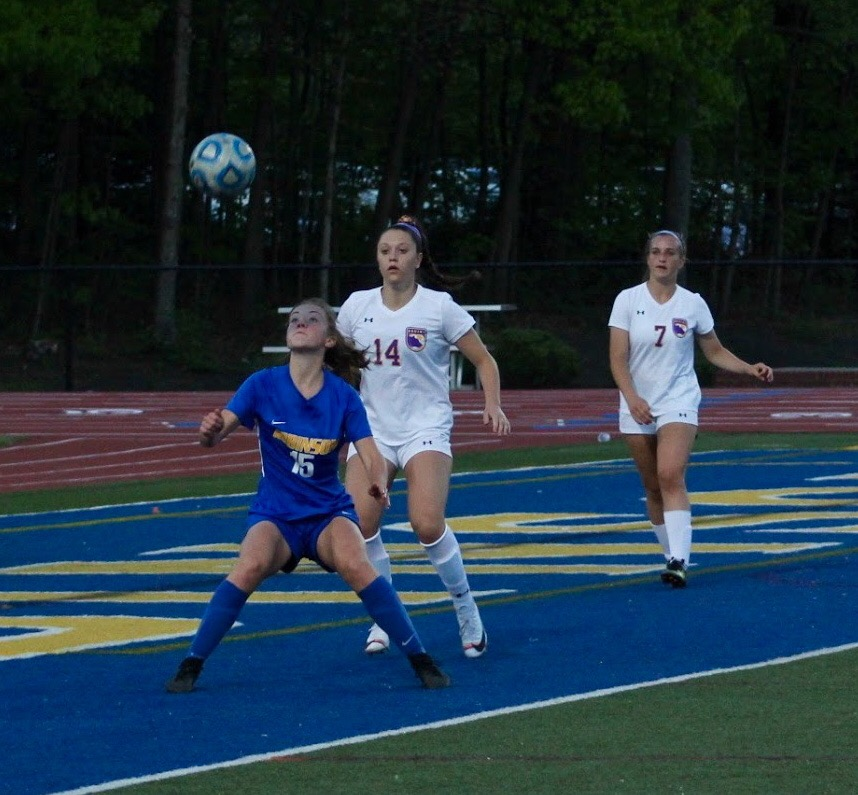 Sophomore, Abby Cruz watches as the ball goes in the air, waiting for it to land on th ground.