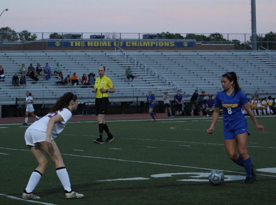 Junior, Ginny Delacruz has possession of the ball as she looks to evade a Lake Braddock player.