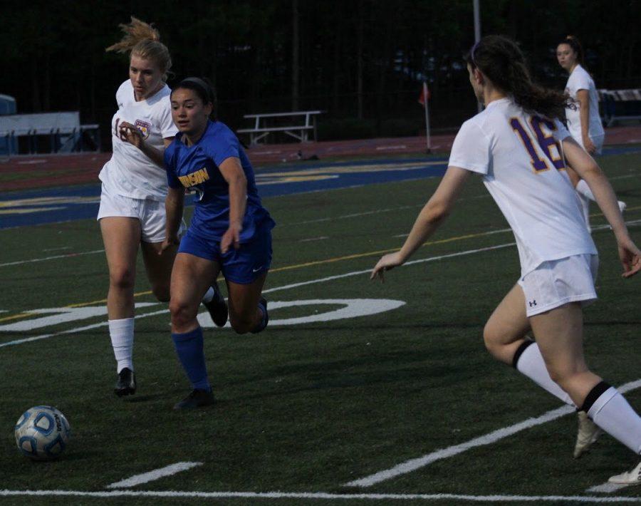 Ginny Delacruz kicks the ball to the sidelines.