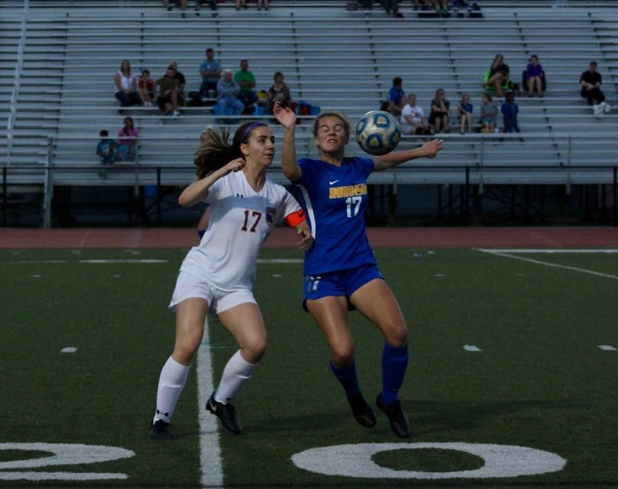 Sophomore, Sammy Haynie braces for impact as the ball aims to hit her head.