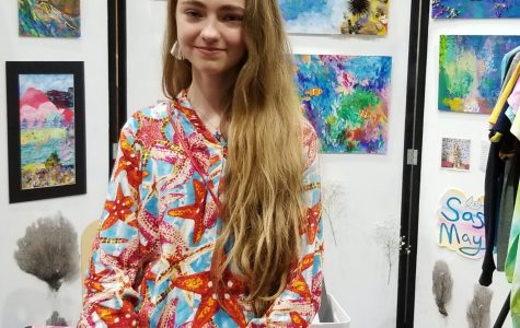 This is Sasha May with her one person booth at the art show.
