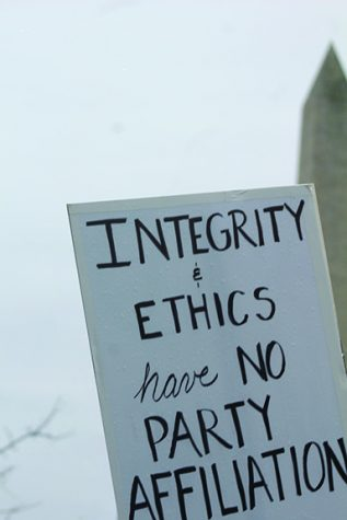 "The photo states ""Integrity & Ethics have no party."""