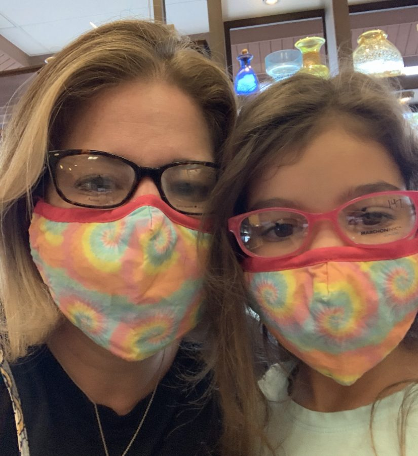 Christine Notarianni and her daughter Alyssa trying on glasses at the Optometrist. Do their glasses match their masks?