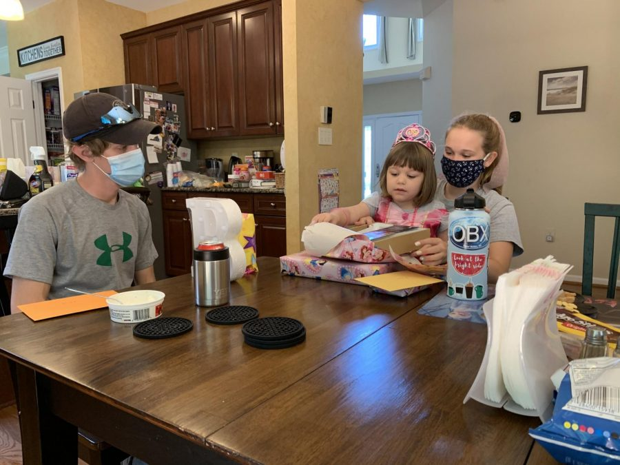 Julie Ross and her family celebrate birthdays late with masks on. They still see family, but are safe in doing so.