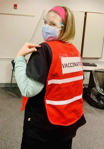 Christine Notarianni rocking her vaccination gear. She wore a mask and a shield to stay protected when distributing vaccines.